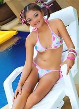 Thai cutie strips from her poka dot bikini by the pool