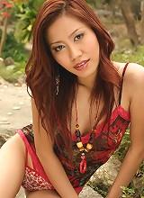Thai Cutie Miki Sukawa Strips Dress On Rocks