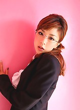Alluring asian secretary poses in her short skirt and stockings