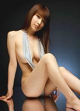 Sexy asian babe Emi Kobayashi in a tight red leather bikini