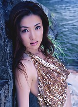Beautiful asian nymph exhibits her pale ivory skin in a bikini