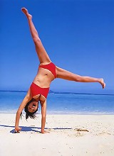 Asian model at the beach showing off her beautiful tits in bikini