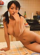 Sakura Shiratori posing topless in the kitchen and playing
