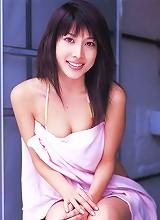 Busty asian beauty enjoying herself in a bikini at the beach