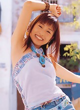 Stunning asian beauty having fun at the beach in her bikini