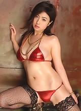 Big breasted gravure idol babe seduces in her skimpy red bikini