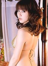 Arousing asian beauty with gorgeous milky white skin in a bikini