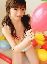 Petite gravure idol hottie is terribly cute in her bright bikini