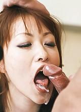 Rika Kurachi Asian in fishnet stockings sucks two hard dicks
