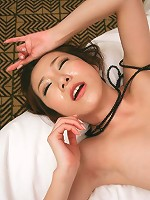 Sultry Kanako Tsuchiyo in black teasing her guy