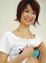 Miriya Hazuki is in green satin before spreading her pussy wide