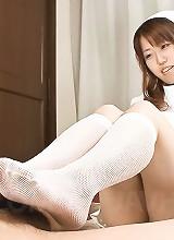 Ai Ootomo Asian nurse in fishnet rubs dick between her boobs