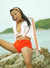 Very petite Thai girl strips at an exotic beach in thailand