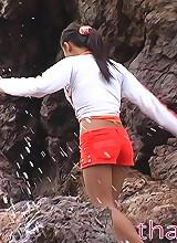 Tiny Thai girl walks around a private beach and sucks cock