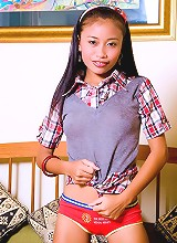 Thainee looking very innocent in a school girl dress