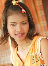 Thai teen Tussinee is smokin with her cute panties