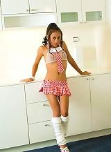 Thainee posing nude in a very cute mini skirt