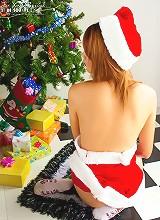 Santa's favorite little helper Jas shows her gifts