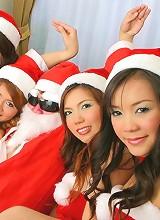 Santa Claus enjoying his harem of Thai toy helpers