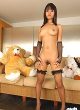 Thai babe Bua nude in stockings