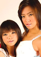 Thai girlfriends Aunchan and Nan kissing